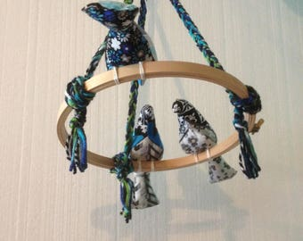 Blue birds on a hoop mobile abstract swirls black and white blossoms birds plushies