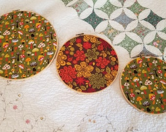 Three decorated embroidery hoops with vintage fabric Mushrooms and flowers room decor