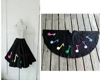 20% OFF / A Tender Melody 1950s/1960s Black Cotton Circle Skirt with Rainbow Colored/Embroidered Music Notes