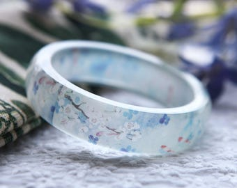 Resin bangle with embedded Asian art of cherry blossom and gold fish