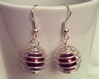 These earrings spiral Brown beads