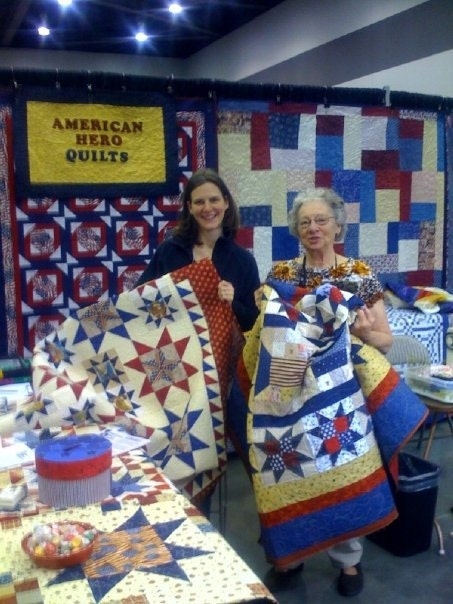 The quilt Im holding...I quilted it!  Came across it while wandering through the show.