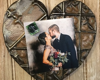 Ornate blush with green and metal colored heart designed with antique tin ceiling tile