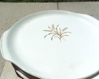 Two handled platter by Universal Ballerina in wheat pattern/two handled/oven proof