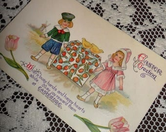 ON SALE Antique Vintage Victorian Easter Greeting Embossed Postcard Early 1900s Dutch Boy Girl carrying gift box with Tulips Windmill Easter