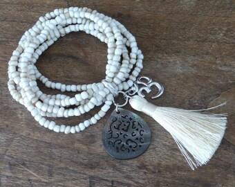 Multi strand bracelet - Bahia Del Sol - mother of pearl - silk pompon - AUM - bohostyle - gypsy - gypset - hippie - bohemian jewelry - Ibiza