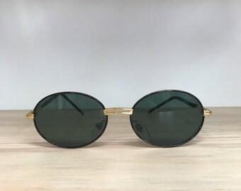 Black with gold bridge vintage sunglasses