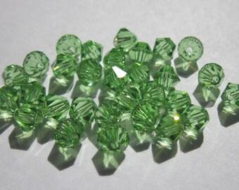 30 genuine swarovski 4mm - peridot AB Crystal bicones (47)