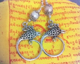 tribal bird and silver round bead earrings