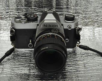 Nikon FM Vintage SLR Camera w/ Micro Nikkor 55mm 1:2.8 lens and Battery Grip