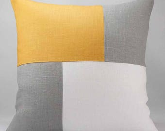 Graphic grey linen, linen white and mustard linen cushion
