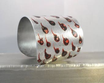 Silver and red cuff