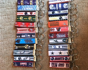 NFL Key Chains, Headband, Lanyards or Backpack Tags: Giants, Eagles, 49ers, Steelers, Browns, Patriots, Saints, Cowboys, Ravens