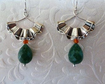 Silver Ruffle Fan Earrings are dimensional double ruffled fans suspending rich green faceted Ropada briolettes, with tiny Carnelian beads.