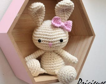 Amigurumi toy crocheted ecru with a bow pink