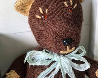 A gorgeous vintage home knitted toy teddy bear made by a great aunt