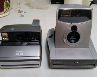 Polaroid camera 1200ff and one