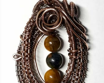 Aged wire woven copper unique handmade pendant with golden pietersite beads