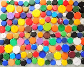 LOT of 140 Plastic bottle caps multiple colors and sizes for crafts!