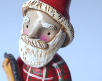 Santa Christmas Decoration holding horse toy original folk art sculpture