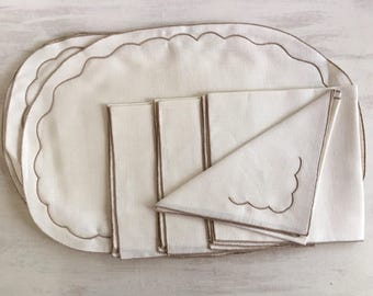 Set of Four Ivory Color Placemats and Matching Napkins