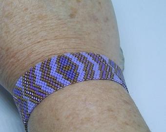 Purple and bronze hand-woven bracelet