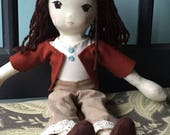 Adorable 13 inch handmade cotton doll with brown hair, brown eyes and interchangeable wardrobe.