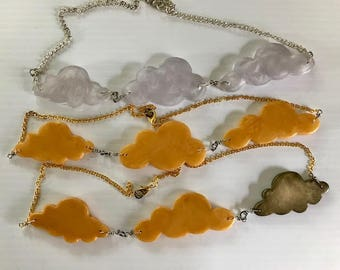 Three clouds floating necklace, clear and swirly, gold, different shapes, whimsical handmade and unique.
