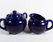 Vintage cobalt blue sugar bowl and creamer set. Fiesta?