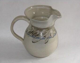 Vintage art pottery pitcher signed