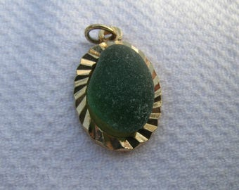 Gorgeous unique vintage upcycled English green sea glass and gold coloured metal pendant