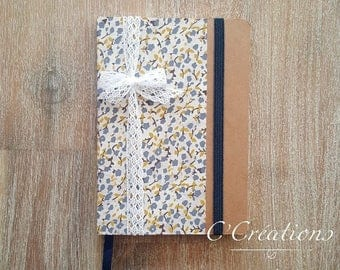 Notebook lined in kraft, blue, yellow