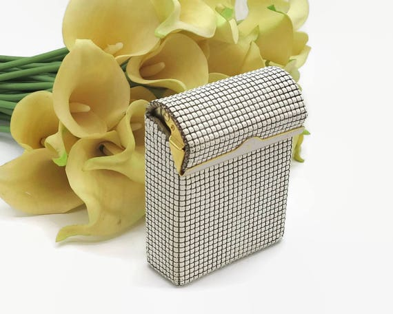 White mesh cigarette case with gold metal and white enamel trim, levered lid, larger size, Glomesh brand, Australia, circa 1970s