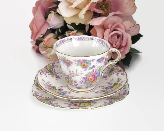 Vintage Colclough cup, saucer, and plate with pattern of multi colored flowers, lots of purple, bone china, England, mid 20th century