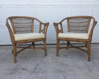 Delightful Mid Century Hollywood Regency pair of Rattan lounge/club chairs.