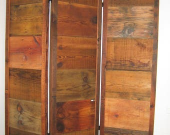 Screen made from reclaimed barn wood.