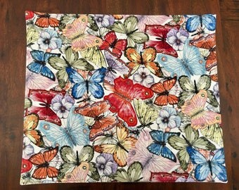 Bright Butterflies fabric placemats in many different designs.Square or rectangle with four, six, eight, ten or twelve settings.Custom made.