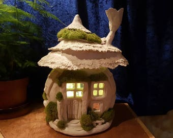 A brand new, one bedroom Fairy house cunningly disgused as an incense burning lamp. BFH...Saving the house fairies one home at a time.