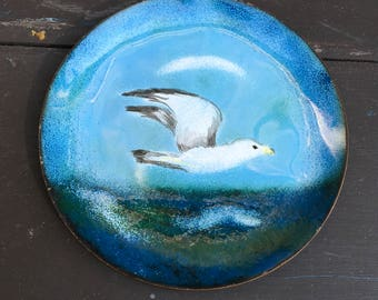 Vintage enameled copper dish with seagull in flight