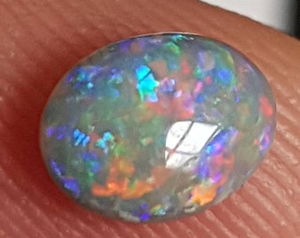 Video available* 0.63ct Oval 7 x 5 x 3.5mm Gem Multicoloured Genuine Lightning Ridge Australian Black Opal Cabochon