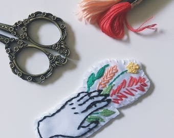Hand Holding Flowers Patch