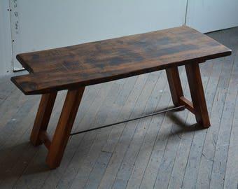 Barnwood Bench made with reclaimed barn joists and mahogany legs.