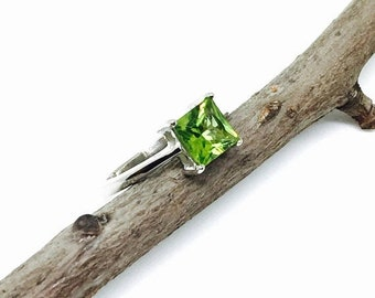 10% Peridot Ring set in sterling silver 92.5. Genuine natural faceted  peridot stone. Size  6 1/2.