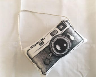Small cushion camera