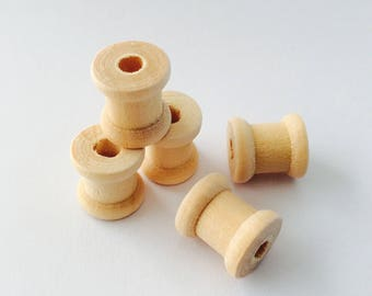 5 miniature raw wooden spools