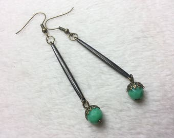 Earrings dangle green baguettes