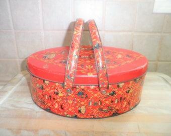 Vintage decorative tin with metal handles