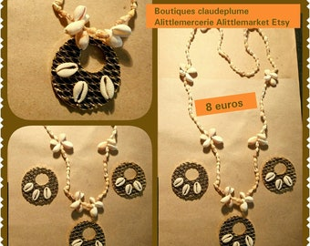 3 Golden pendants and a cowrie shell necklace