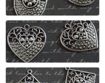 Large ornate silver metal pendant charm