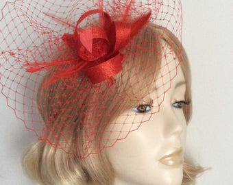 RED SINAMAY FASCINATOR, With fine net, stripped hackle ,coque feathers, all on a clip